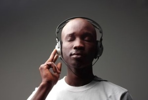 Photo of a man listening to music