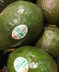 photo of avocados with stickers on them